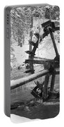 Water Wheel In Snow Portable Battery Charger