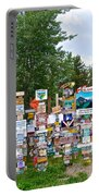 Watson Lake Sign Forest Along Alaska Highway In  Yukon-canada Portable Battery Charger