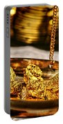 Weighing Gold Portable Battery Charger