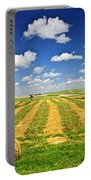 Wheat Farm Field And Hay Bales At Harvest In Saskatchewan Portable Battery Charger
