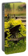 Wheel Barrow Of Flowers Portable Battery Charger
