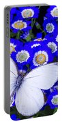 White Butterfly In Blue Flowers Portable Battery Charger