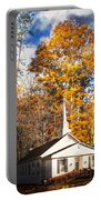White Church In Autumn Portable Battery Charger