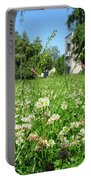 White Clover Field And The Playground Portable Battery Charger