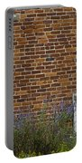 White Door In Brick Building Portable Battery Charger