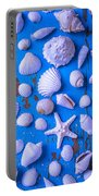 White Sea Shells On Blue Board Portable Battery Charger