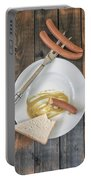 Wieners Portable Battery Charger by Joana Kruse