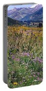 Wildflowers And Mountains  Portable Battery Charger