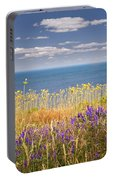 Wildflowers And Ocean Portable Battery Charger