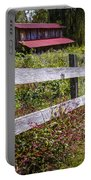 Wildflowers At The Fence Portable Battery Charger