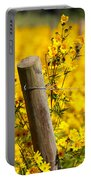 Wildflowers On Fence Post Portable Battery Charger