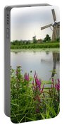 Windmills Of Kinderdijk With Wildflowers Portable Battery Charger by Carol Groenen