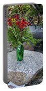 Wine And Red Flowers On The Rocks Portable Battery Charger