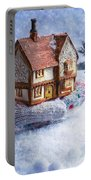 Winter Cottage In Gloved Hand Portable Battery Charger