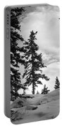 Winter Pines Silhouetted Against The Sky Portable Battery Charger