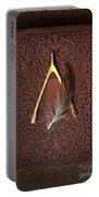 Wishbone And Feather On Antique Book Portable Battery Charger