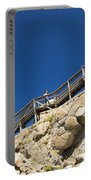 Woman Climbing Stairs Portable Battery Charger