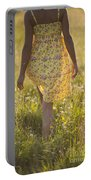 Woman In A Yellow Flowery Dress Walking In A Summer Meadow Portable Battery Charger