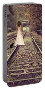 Woman On Railway Line Portable Battery Charger