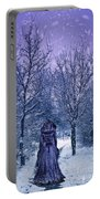 Woman Walking In Snow Portable Battery Charger by Amanda Elwell