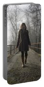 Woman Walking With Her Dog On A Bridge Portable Battery Charger