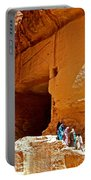 Women Leaving A Storage Place Near The Treasury In Petra-jordan Portable Battery Charger