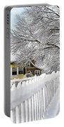 Yellow House With Snow Covered Picket Fence Portable Battery Charger
