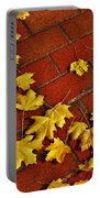 Yellow Leaves On Red Brick Portable Battery Charger