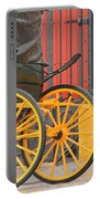 Yellow Wheeled Carriage In Seville Portable Battery Charger