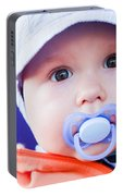 Young Baby Boy With A Dummy In His Mouth Outdoors Portable Battery Charger
