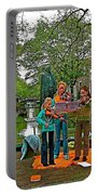Young Musicians On Orange Day By A Canal In Enkhuizen-netherland Portable Battery Charger