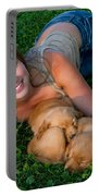 Young Woman And Golden Retriever Puppies Portable Battery Charger