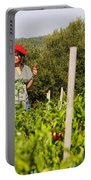 Young Woman Harvesting Red Peppers Portable Battery Charger