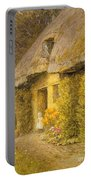 A Child At The Doorway Of A Thatched Cottage  Portable Battery Charger