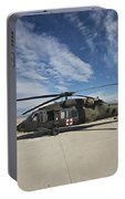 A Uh-60l Blackhawk Parked On Its Pad Portable Battery Charger