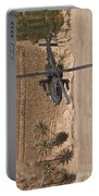 An Ah-64d Apache Helicopter In Flight Portable Battery Charger