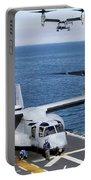 An Mv-22 Osprey Tiltrotor Aircraft Portable Battery Charger