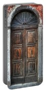 an old wooden door in Italy Portable Battery Charger by Joana Kruse