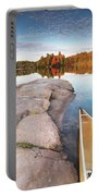Canoe At A Rocky Shore Autumn Nature Scenery Portable Battery Charger
