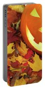 Carved Pumpkin On Fallen Leaves Portable Battery Charger