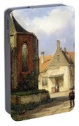 Figure Before A Redbrick Church In A Dutch Town Portable Battery Charger