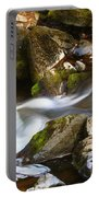 Flowing River Blurred Through Rocks Portable Battery Charger