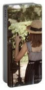 Girl Looking Over Iron Gate Portable Battery Charger