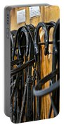 Horse Bridles Hanging In Stable Portable Battery Charger
