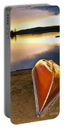 Lake Sunset With Canoe On Beach Portable Battery Charger