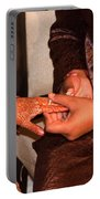 Putting The Gold And Diamond Engagement Ring On The Finger Of The Lady Portable Battery Charger