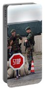 Scenery Of A Checkpoint Used Portable Battery Charger by Luc De Jaeger