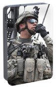 U.s. Army Soldier Communicates Portable Battery Charger