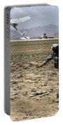 U.s. Army Soldier Launches An Rq-11 Portable Battery Charger