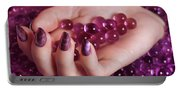 Woman Hand With Purple Nail Polish On Candy Portable Battery Charger